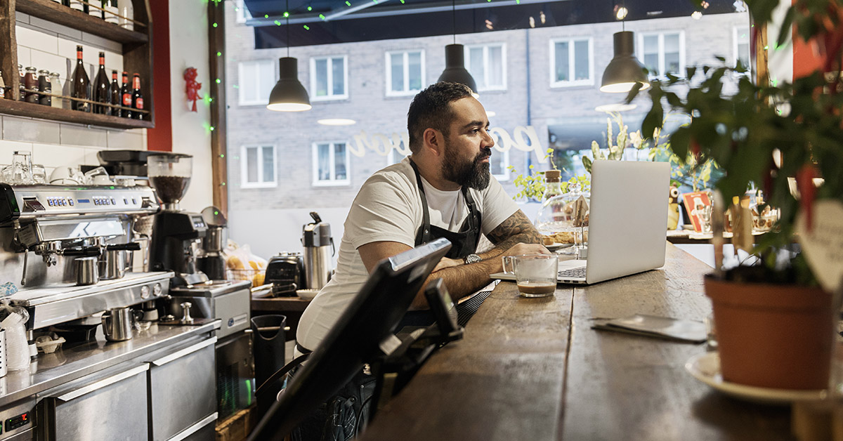 cafe owner working on computer