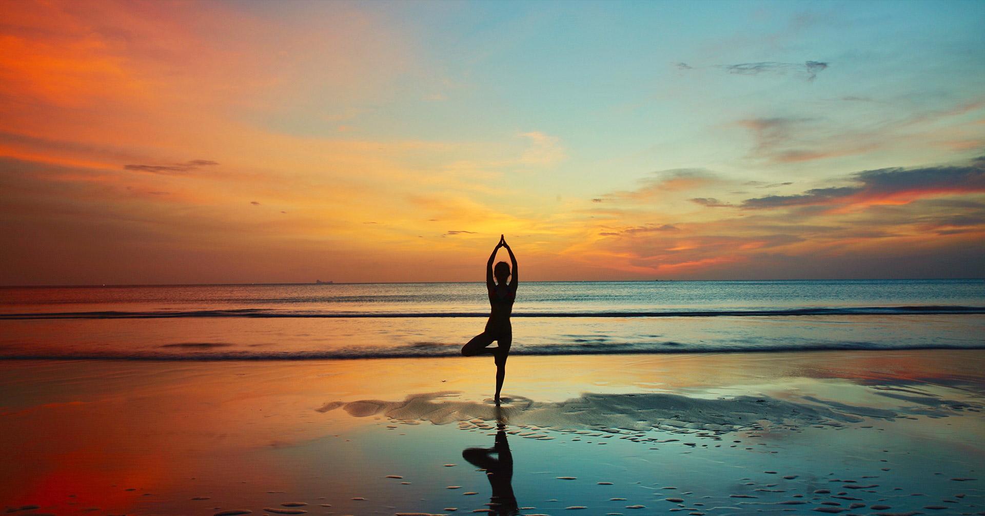 yoga tree pose sunset ocean